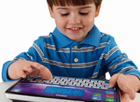 Child Playing On Computer Tablet